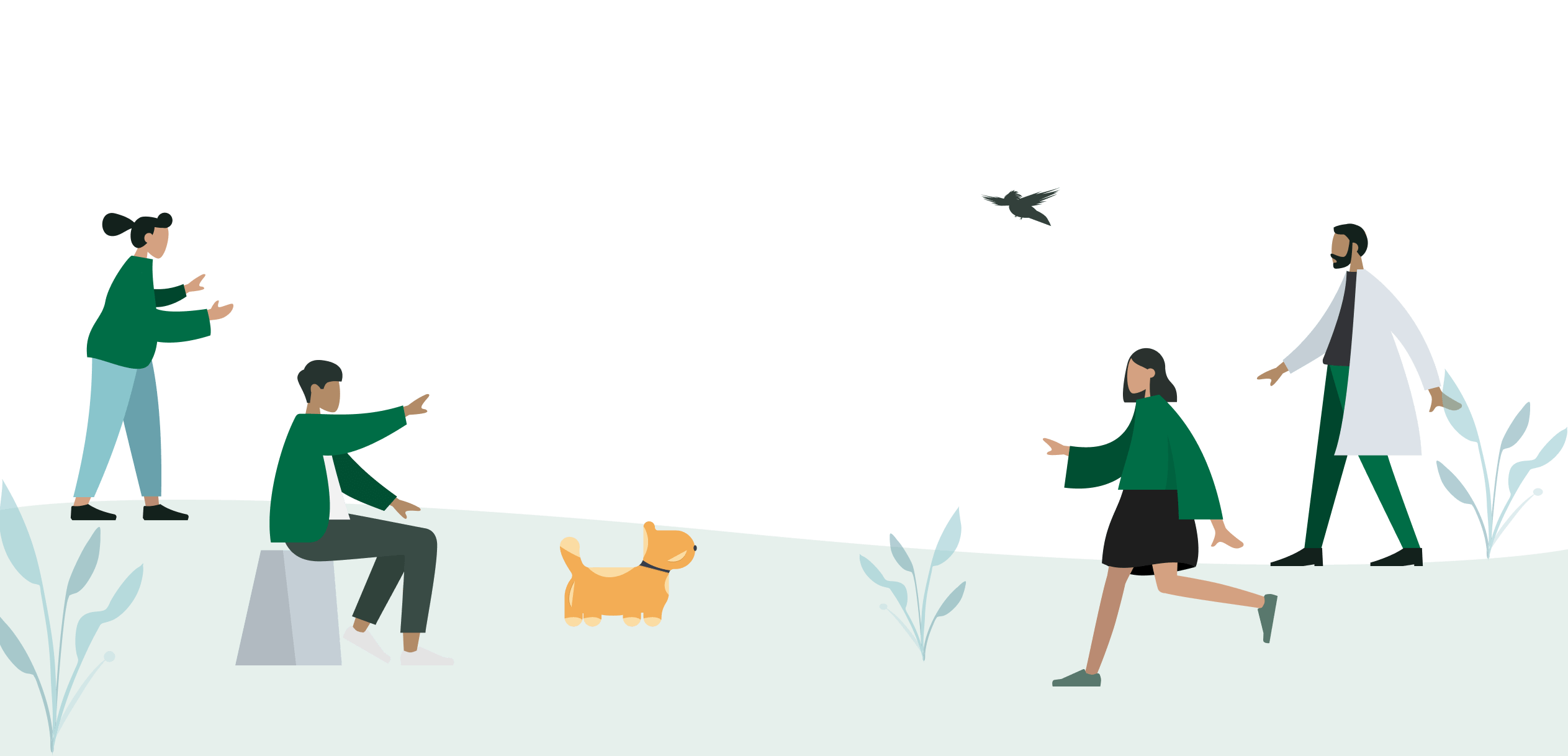 People playing in a field with a dog.